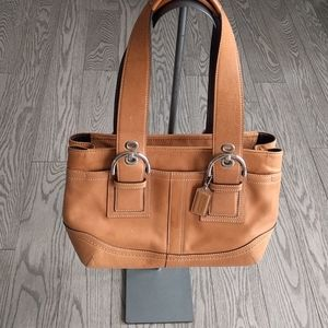 Beautiful genuine leather bag by Coach 🍀